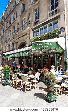 PARIS -May 16, 2017: View of vintage paris cafe de Belle epoque in quarter of commercial Bourse in Paris, France