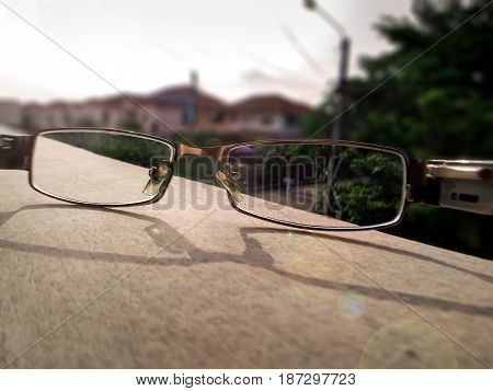 Seeing Through the Lens of a Pair of Glasses on a Sunny Day