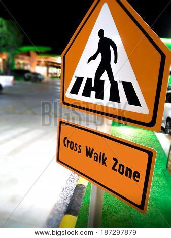 Pedestrian Cross Walk Sign in a Commercial Zone