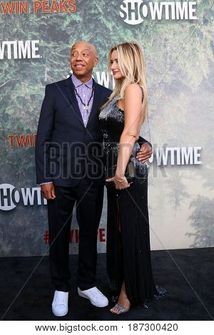 LOS ANGELES - MAY 19:  Russell Simmons, Amy Shiels at the