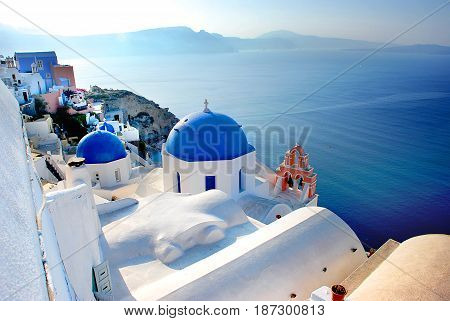Stunning view of the caldera in Santorini Greece with iconic blue domed churches