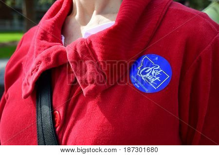 MISSOULA, MONTANA, USA - May 20, 2017: Woman wearing a Rob Quist for Montana sticker on her shirt