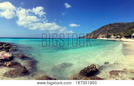 Turquoise Caribbean waters and sandy beach in Curacao