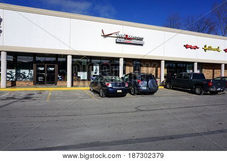 BAY VIEW, MICHIGAN / UNITED STATES - NOVEMBER 26, 2016: One may sign up for Verizon Wireless cellular telephone service, from a premium retailer in a Bay View strip mall.