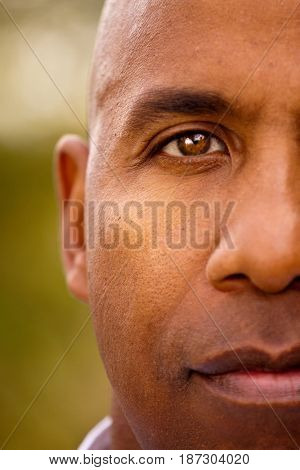 Mature African American man looking into the camera.