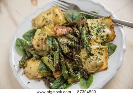 Ricotta tortellini with green asparagus and fresh herbs