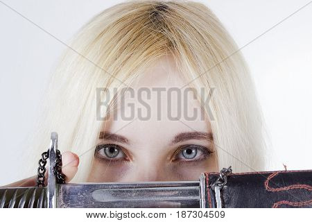Young woman with gray eyes close-up on a white background