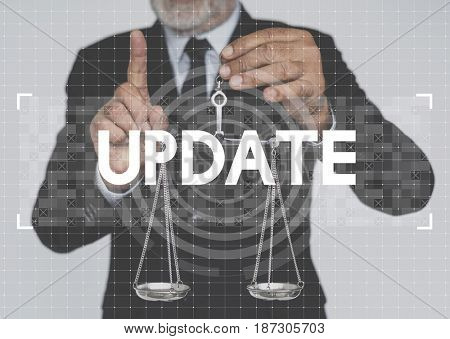Businessman holding scale and update word