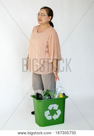Adult Woman and Separated Plastic Bottles Recyclable
