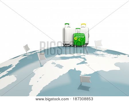 Luggage With Flag Of Cocos Islands. Three Bags On Top Of Globe