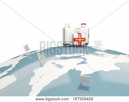 Luggage With Flag Of Guernsey. Three Bags On Top Of Globe