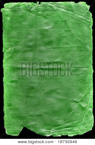 Old green paper isolated on black
