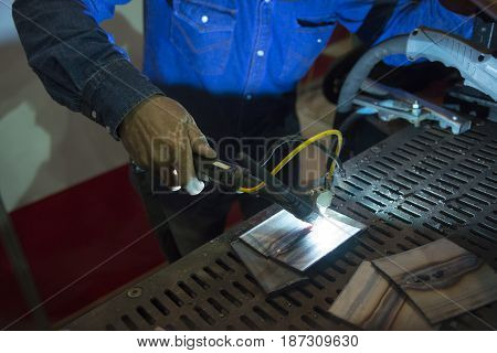The craftsman welding the metal tube .Hi-technology manufacturing concept