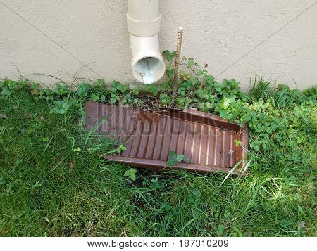 pvc gutter downspout pipe and green grass