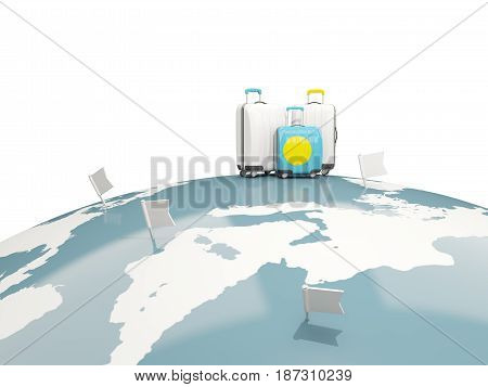 Luggage With Flag Of Palau. Three Bags On Top Of Globe