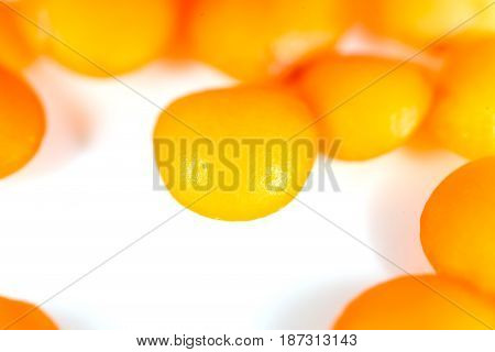 Red lentils on a white background. macro