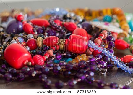 Colorful bijouterie. Necklaces with beads. Close up.