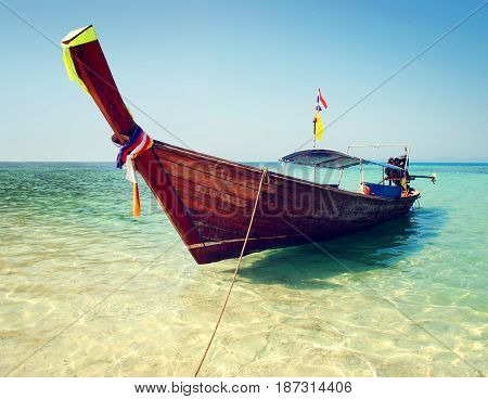 Traditional longtail boat floating in clear waters of Thailand
