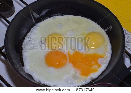 Cooking of fried eggs. Eggs are fried in a frying pan.