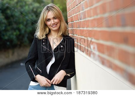 Beautiful Young Blonde Woman In Urban Background