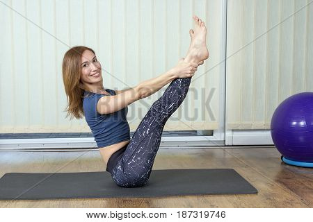 Happy Young Woman Working Out In Home Gym