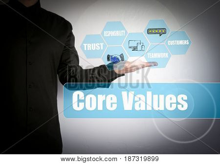 Core Values concept. Successful businessman at the light background.