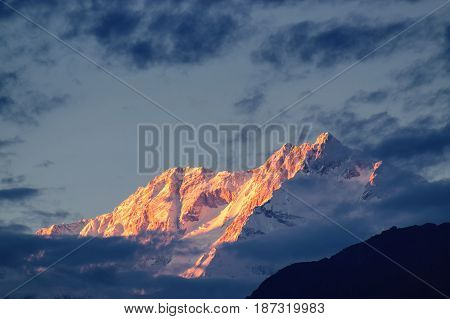 Beautiful last light from sunset on Mount Kanchenjugha Himalayan mountain range Sikkim India. color tint on the mountains at dusk