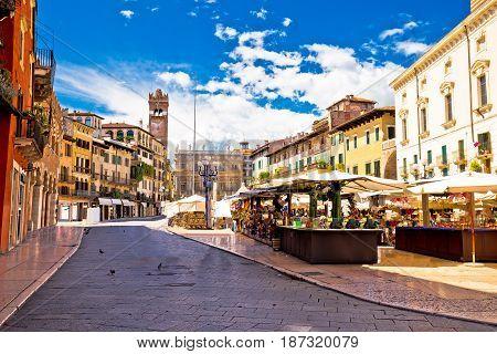 Piazza Delle Erbe In Verona Street And Market View