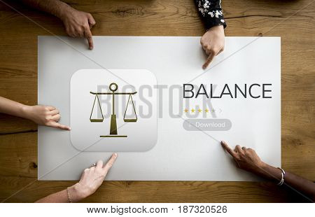 Diverse Hands point on a law concept on wooden table