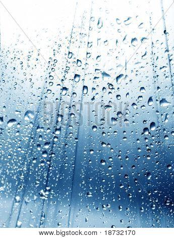 Rain drops on blue background