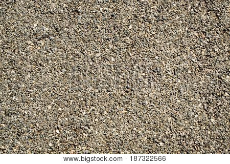 Vintage small stone of asphalt road texture for background.
