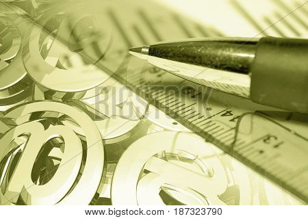 Business background in sepia with pen mail signs and ruler.