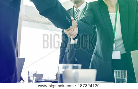 Business people greeting handshaking deal together