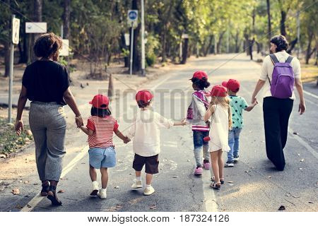 Little Kids with Teacher  Walking Together Field Trip