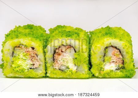 three green rolls closeup isolated on gray background