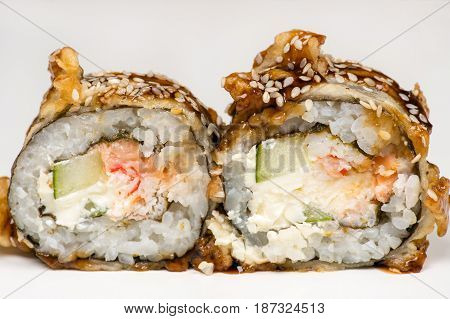 hot sushi roll with salmon closeup isolated on gray background