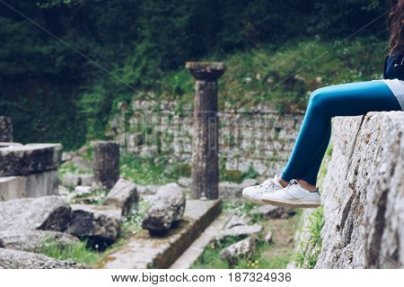 Girl Is Sitting On Remains Of A Doric Temple, Mon Repos Park, Corfu Town, Greece