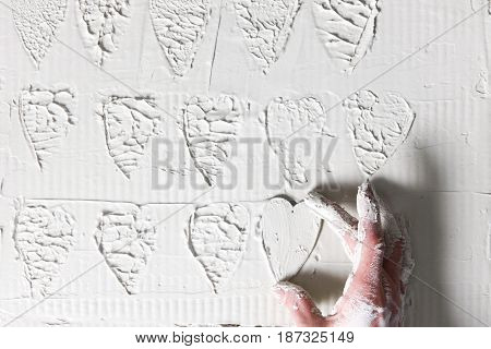 Hand Heart Stamp White Plaster Background Decorative Stucco Pattern Handmade Love Concept