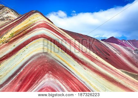 Vinicunca Peru - Rainbow Mountain (5200 m) in Andes Cordillera de los Andes Cusco region in South America.