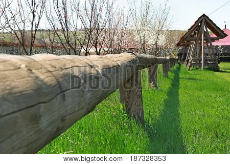 Wooden enclosure in orchard on farm