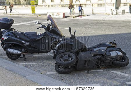 PARIS FRANCE - APRIL 2 2017: A fallen motor scooter in the parking lot. Paris France.