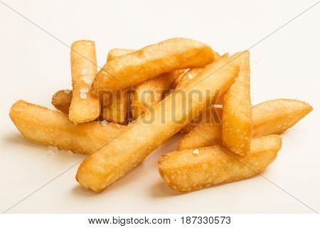 french fries with coarse salt on white background