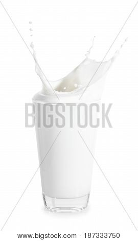 splashes of milk from the glass isolated on white background with clipping path. Big glass of milk. Pouring milk