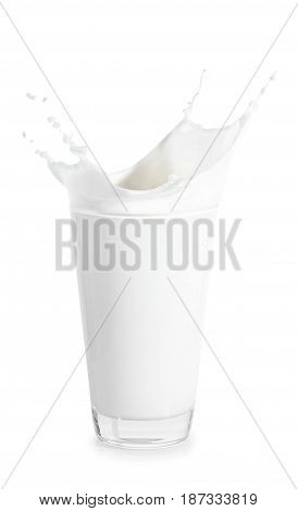 splashes of milk from the glass isolated on white background. Big glass of milk