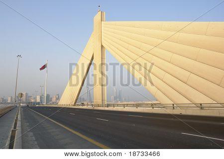 Manama scene from Shaikh Isa bin Salman bridge that connects Manama and Muharraq in Bahrain poster