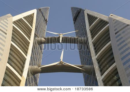 Bahrain  World Trade Center. Very modern and artful building that projected to supply its own energy consumption  via huge wind turbines. This is close-up to wind turbines