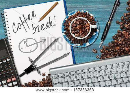Coffee break time in office - Desk with a coffee cup with roasted coffee beans computer keyboard pencil calculator and drawing compass