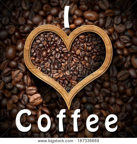 I Love Coffee - Roasted coffee beans in a heart shaped wooden frame with many coffee beans on background