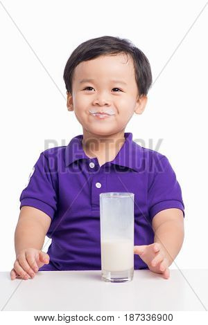 Adorable Baby Boy With Dringking Milk With Milk Mustache Holding Glass Of Milk