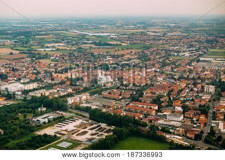 Bergamo, Italy. Aerial View Of Cityscape From Plane Flight Attitude.